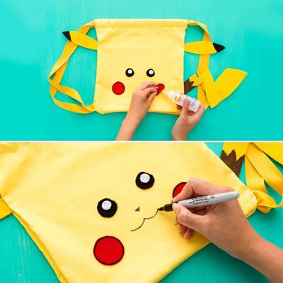 may túi hình pikachu đi bắt pokemon